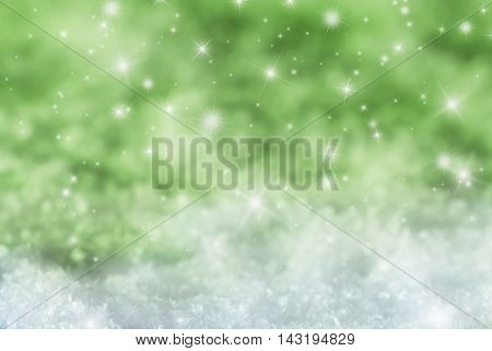 Christmas Texture With Sparkling Stars. Snow With Green Background. Copy Space For Advertisement. Card For Seasons Greetings