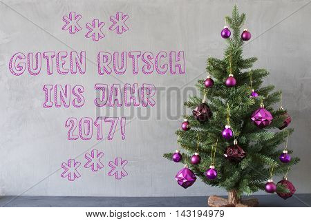 Christmas Tree With Purple Christmas Tree Balls. Card For Seasons Greetings. Gray Cement Or Concrete Wall For Urban, Modern Industrial Styl. German Text Guten Rutsch Ins Jahr 2017 Means Happy New Year