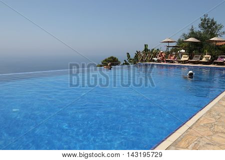 29TH JULY 2016, KABAK, TURKEY : English tourists having a swim and cooling off in an infinity pool at Kabak in Turkey, 29th july 2016