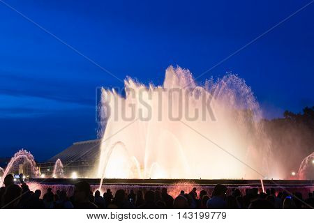 Barcelona Spain - May 102016. A crowd of people watches evening show of Magic Fountain in Barcelona.