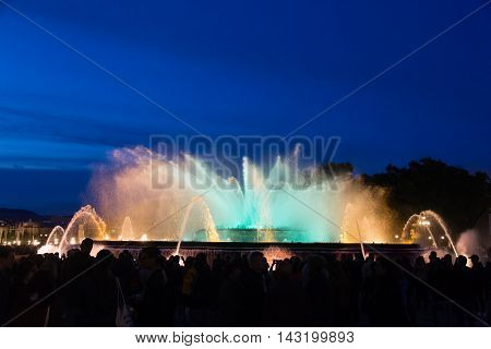 Barcelona Spain - May 24 2016. A crowd of people watches evening show of Magic Fountain in Barcelona