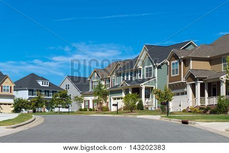 Street of suburban residential houses with porches