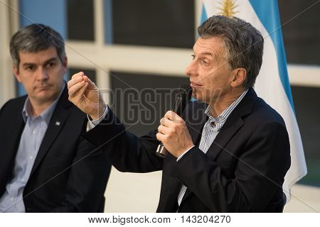 Olivos Argentina - May 6 2016: President of Argentina Mauricio Macri (R) and Chief of the Cabinet of Ministers of Argentina Marcos Pena (L) during a press conference at the presidential residence.