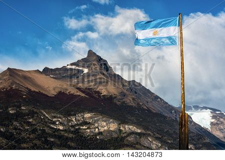 Argentine flag flying in front of the mountain Cerro Moreno in Los Glaciares National Park Argentina