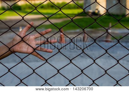 Hand catch on the grille, Use for Background
