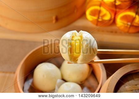Chinese dumplings with yellow egg inside on bamboo tray