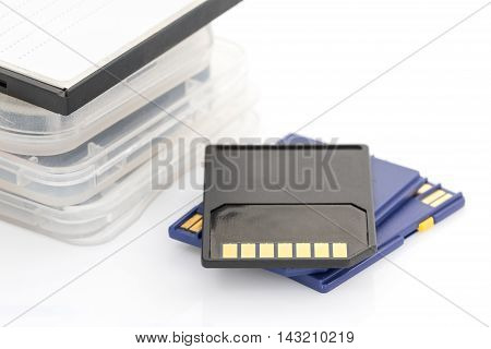 Close up SD memory card and case on white background
