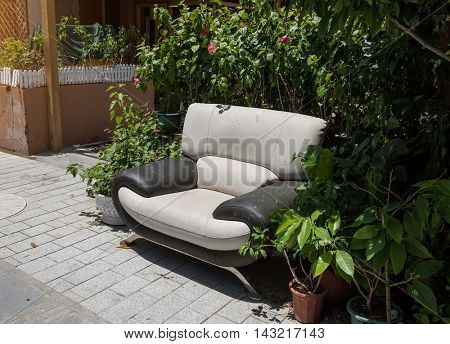 old abandoned house front with sofa