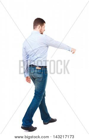 Back view of going  business man pointing. walking young guy . Rear view people collection.  backside view of person.  Isolated over white background. Bearded businessman in a white shirt goes