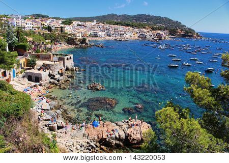 GIRONA/SPAIN - 13 AUGUST 2016: People enjoying summer on a clean transparent beach in the village of Calella de Palafrugell in Costa Brava