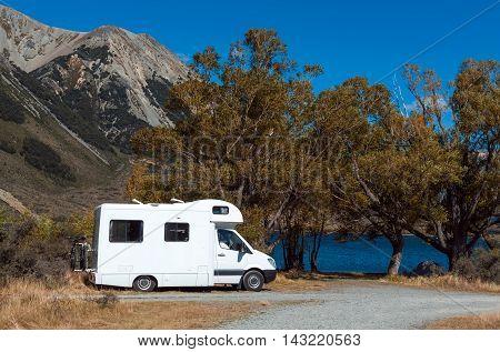 Motorhome Camper At Lake Pearson / Moana Rua Wildlife Refuge Located In Craigieburn Forest Park In C