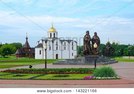 VITEBSK BELARUS - JULY 13 2016: Monument to Prince Alexander Nevsky and his wife Princess Alexandra of Vitebsk and son of Basil Annunciation Church and Church of Holy Prince Alexander Nevsky