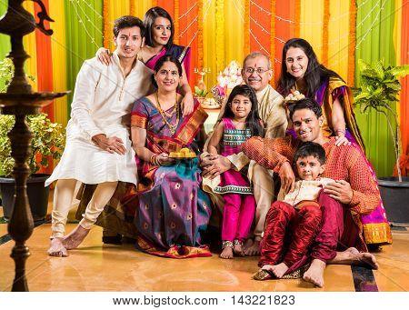 group photo of happy indian family in ganesh festival, happy indian family celebrating ganpati festival or ganesh utsav or ganesh festival