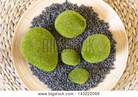 Decorative grasses pebbles on bamboo weaving background