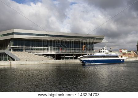 AARHUS DENMARK - AUGUST 14 2016: Modern architecture on Aarhus Dockland and express ferry to island Samsoe - Dokk1 has just been named the world's best public library. August 14 2016