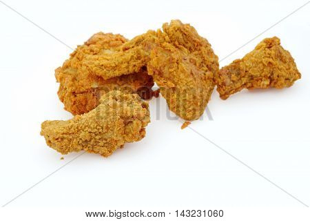 Golden color Fried chicken on white background.