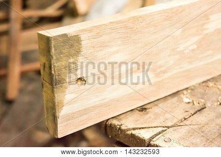 Old cabinet scraper spokeshave sapele exotic hardwood sawdust board chip shavings.