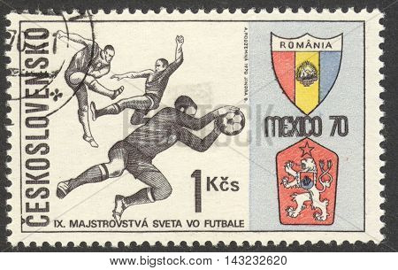 MOSCOW RUSSIA - CIRCA JUNE 2016: a post stamp printed in CZECHOSLOVAKIA shows Three Players and Badges of Romania and Czechoslovakia the series