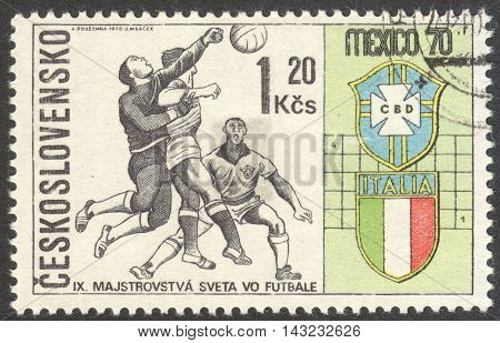 MOSCOW RUSSIA - CIRCA JUNE 2016: a post stamp printed in CZECHOSLOVAKIA shows Three Players and Badges of Brazil and Italy the series