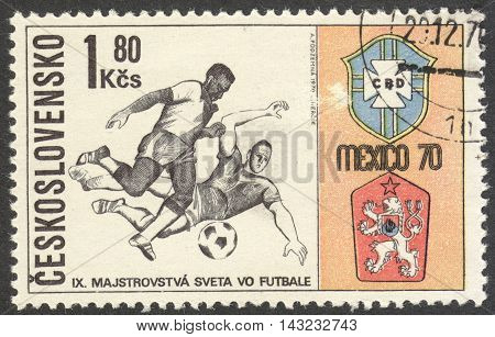 MOSCOW RUSSIA - CIRCA JUNE 2016: a post stamp printed in CZECHOSLOVAKIA shows Two Players and Badges of Brazil and Czechoslovakia the series