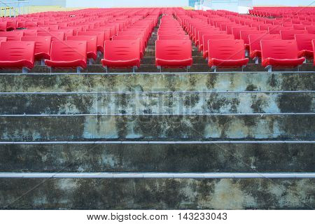 row of red stadium chair seat no people