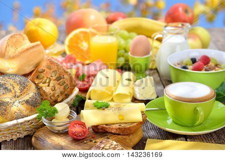 Outside served breakfast with a cup of cappuccino and a large selection of food