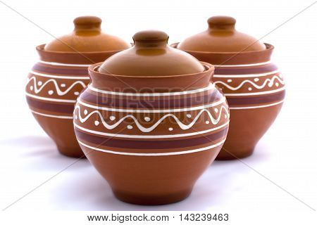 Three Clay Pots On A White Background