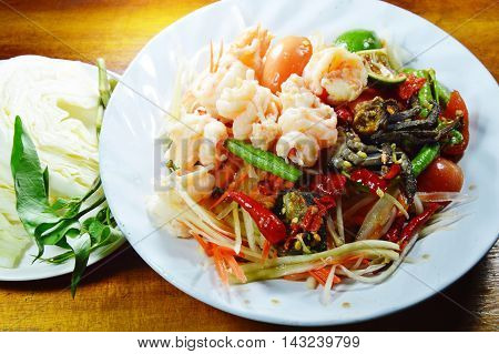 papaya salad called Som tum in Thai eat couple with fresh vegetable on table