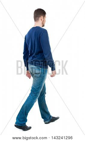 Back view of going  handsome man. walking young guy . Rear view people collection.  backside view of person.  Isolated over white background. bearded man in blue pullover goes diagonally.