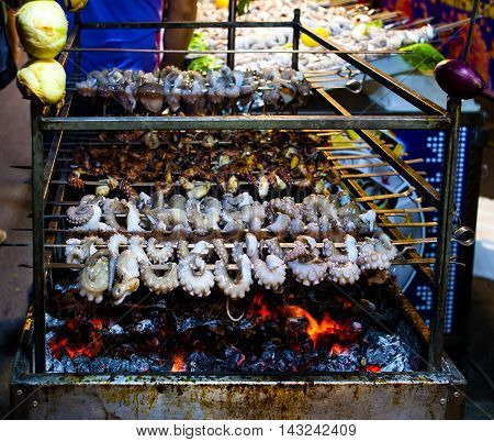 grilled octopus grilled during the course of a festival in Mola di Bari. Apulia - Italy