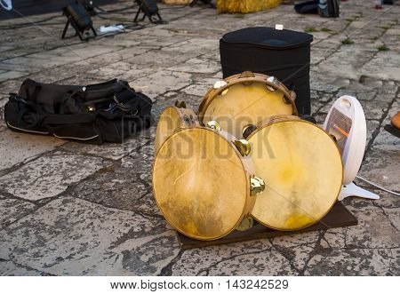 the skin of the tambourines of a folk band of heated Puglia to improve the sound. Italy Note the presence of an electric heater.