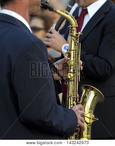 Detail of a musician plays the saxophone reading the score (shallow focus).