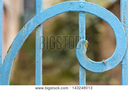Rusty Blue Painted Metal Spiral Closeup. Fibonacci Golden Ratio Spiral and Rule of Thirds Example. Vintage Metal Spirale Decoration. Metal Fence Ornament Abstract Pattern Element.