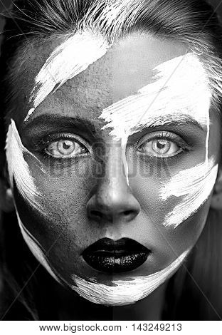 Process of photo retouching black and white portrait of girl with art make-up. Half of the girl face without professional retouching and processing and half of the face is clean and porcelain look.