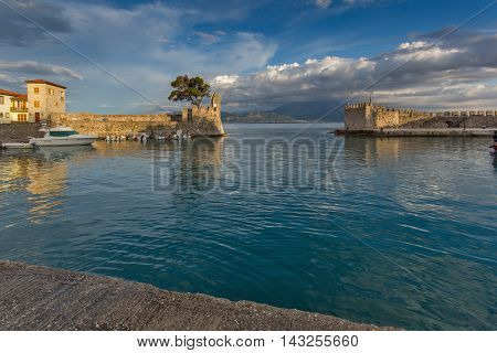 Amazing Sunset of Fortification at the port of Nafpaktos town, Western Greece