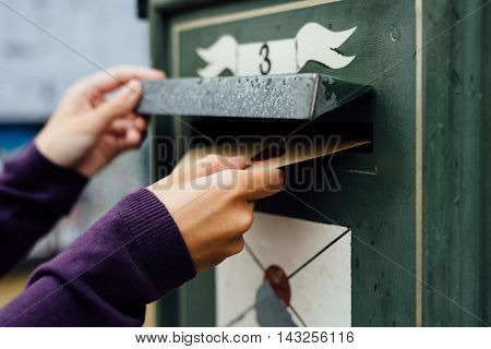 Posting Letter To Old Postbox On Street
