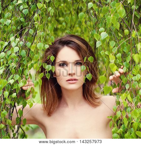 Woman with Green Leaves. Model after the sauna Spa and Sauna Concept