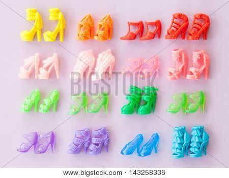 Variety of colorful high heeled woman shoes