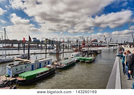 HAMBURG, GERMANY - MARCH 26, 2016: The Landungsbruecken of St. Pauli are a very attractive spot for tourists and visitors who enjoy sightseeing in combination with maritime atmosphere.