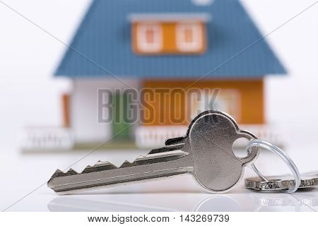 keys and house concept of buying new real estate