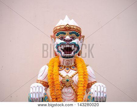 Hanuman statue with yellow garland thailand style