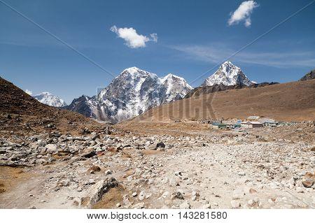 Lobuche village and mt. Lobuche in background from route to mt. Everest Base Camp Sagarmatha National Park Solu Khumbu Nepal.