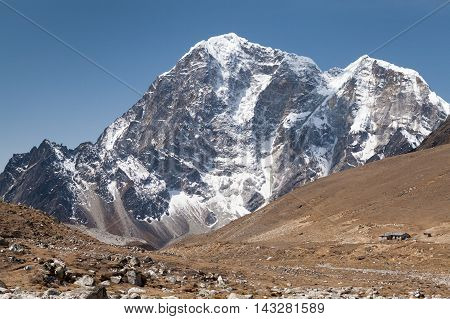 Summit of mt. Lobuche from route to mt. Everest Base Camp near Gorak Shep Sagarmatha National Park Solu Khumbu Nepal.