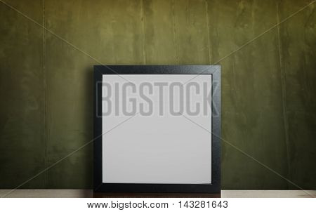 Thick photo frame on Rustic Greeny cement wall. Blank picture frame on table with vintage background. Empty photo frame for your picture or text editing.