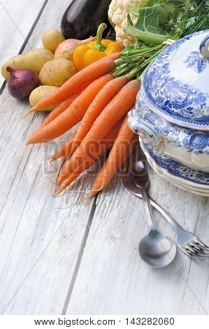raw vegetables for potage with soupbowl and tablespoon