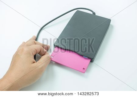 black external usb floppy disk drive with a white disk  white background