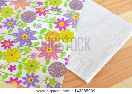 Napkin with flower pattern divided into 2 parts for decoupage. Step
