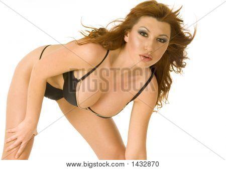 Beautiful Redheaded Woman In Black Bikini Bending Down