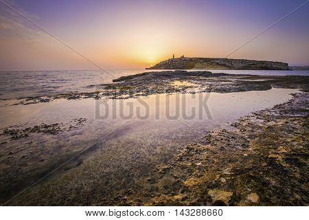 Sunrise at St.Paul's Island in Malta with clear blue sky