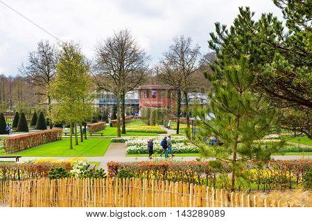 Lisse, Netherlands - April 4, 2016: People walking in dutch spring garden Keukenhof, Lisse, Netherlands
